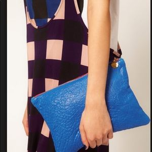 Clare Vivier flat clutch blue pebbled leather
